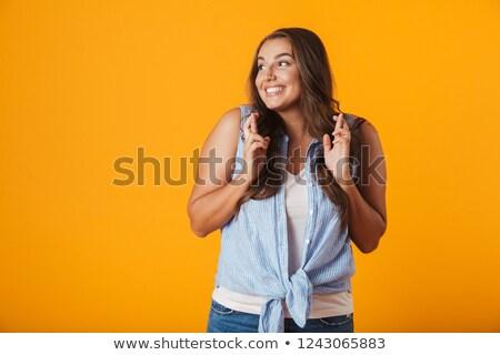 Heureux jeune femme posant isolé jaune mur Photo stock © deandrobot