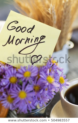 Coffee mug with bouquet of flowers lavender and notes good morning stock photo © Illia