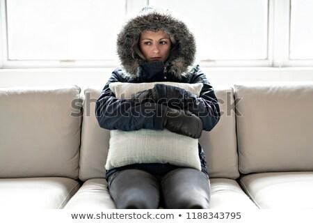 Mulher gripe sofá casa inverno casaco Foto stock © Lopolo