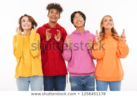 Stock photo: Young group of friends students standing isolated over white wall background showing hopeful gesture