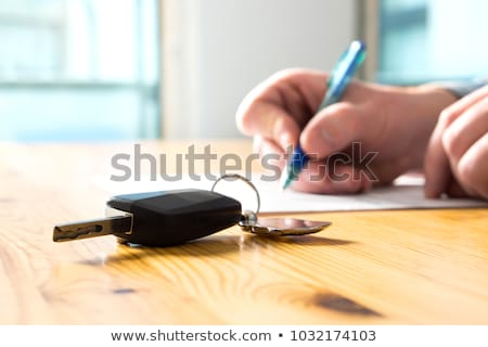 rental agreement for signing a car insurance policy document and stock photo © snowing