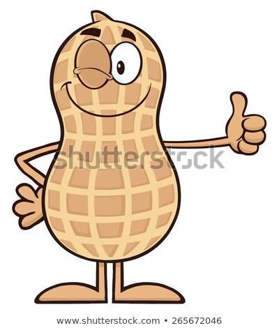 Winking Peanut Cartoon Character Giving A Thumb Up Stock photo © hittoon