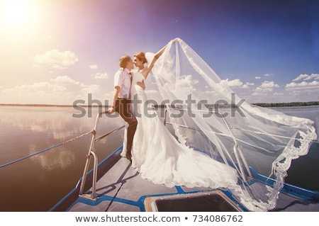A Just married couple on yacht. Happy bride and groom on their wedding day Stock photo © ElenaBatkova