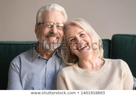 Idős pár férj feleség ül kanapé Stock fotó © UrchenkoJulia
