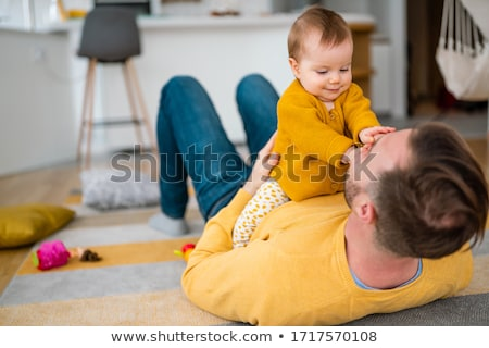Happy young father playing with little daughter Stock photo © Lopolo