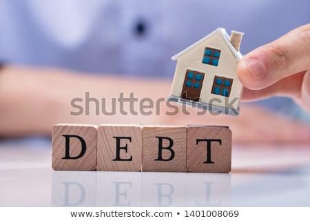 Biznesmen domu modeli dług bloków strony Zdjęcia stock © AndreyPopov