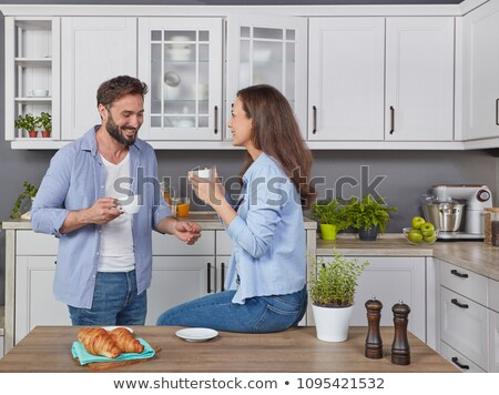 happy couple drinking coffee and eating at home Stock photo © dolgachov