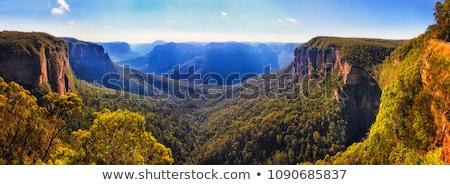 Cachoeira desfiladeiro azul montanhas luz solar enseada Foto stock © lovleah