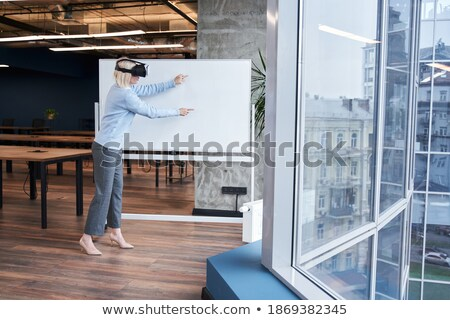 Young female employee in vr goggle attenting virtual training Stock photo © pressmaster
