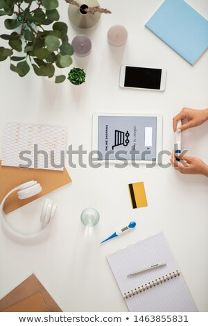 Female hands with pregnancy test and touchpad with basket and search line Stock photo © pressmaster