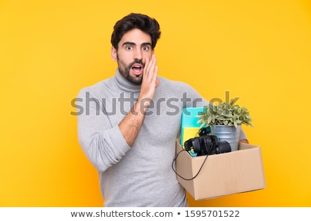 Young handsome man moving in to new house with boxes  Stock photo © Elnur