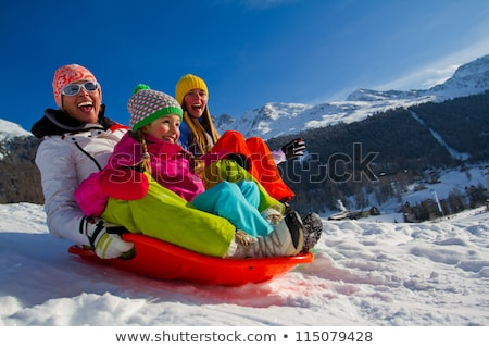 Family In Snow Riding On Sledge stock photo © monkey_business