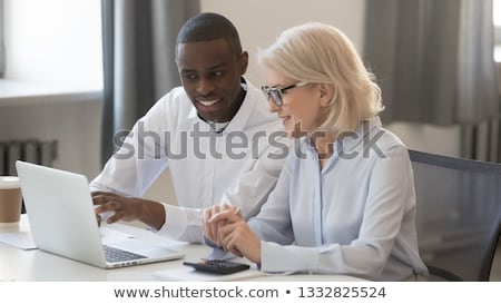 Two Worker Calculating Report In Office Stock photo © AndreyPopov