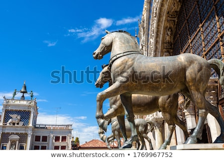 Bronze horses of Saint Mark on top of the St Mark`s Basilica in  Stock photo © boggy