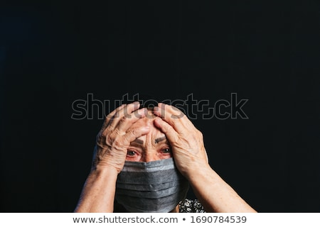 Girl with two flu black background Stock photo © Lopolo