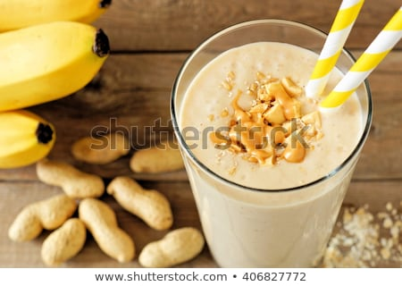 Сток-фото: Banana Smoothies And Bananas On An Old Wooden Background
