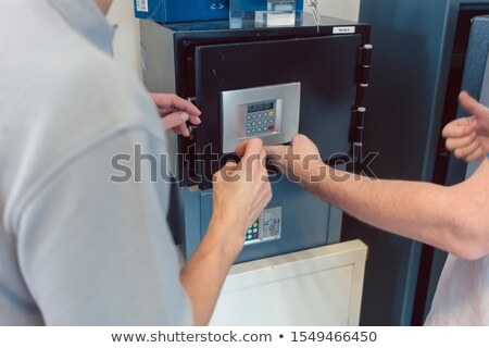 Seller in his shop with customer selling a safe Stock photo © Kzenon