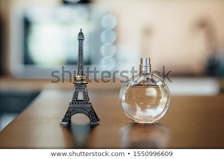 wedding rings on a eiffel tower statue on a wooden table Stock photo © ruslanshramko