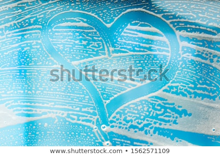 Heart Shape On Abstract Soap Suds Over Window Stock photo © AndreyPopov