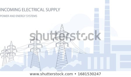 Tangent towers, high voltage power line pylons and city silhouet Stock photo © gomixer