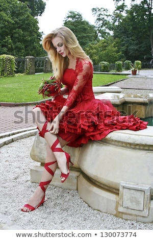 Woman in a luxurious lace dress in the garden with flowering trees Stock photo © ElenaBatkova