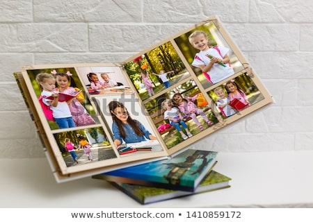 Couple Looking Photo Family Album Book Stock photo © AndreyPopov