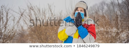 The man was very froze in winter under snowfall. Winter problems Stock photo © galitskaya