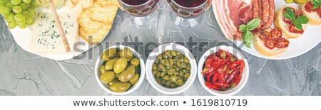 Italian antipasti wine snacks set. Antipasto with jerky, salami, Stock photo © Illia
