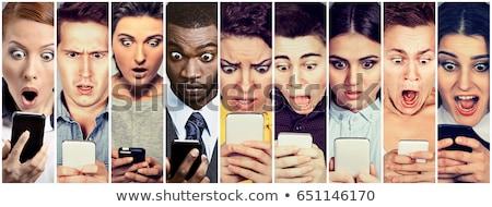 Giovani shock sorpresa persone guardare cellulare Foto d'archivio © dacasdo