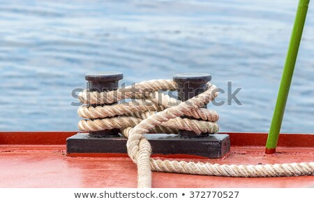 Metal bollard with rope on a ship deck Stock photo © dsmsoft