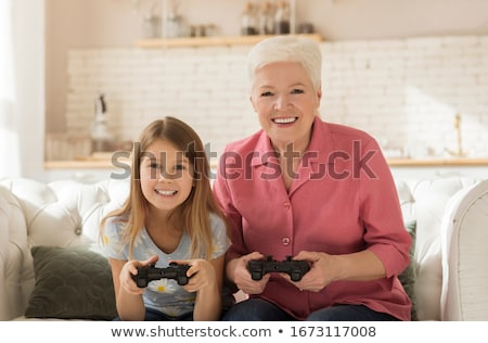 Grandmother playing a video game with her granddaughter Stock photo © photography33