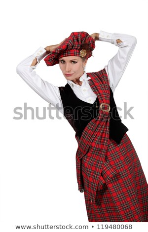 a young woman wearing a scottish costume and looking at us stock photo © photography33