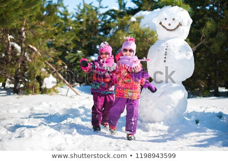 kid girl with snow winter glasses and white fur stock photo © lunamarina
