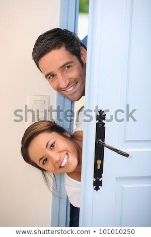Około przednie drzwi kobieta domu para Zdjęcia stock © photography33