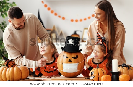 Mother and daughter carving jack-o-lanterns Stock photo © photography33