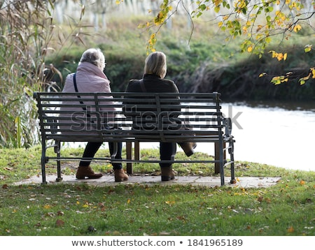 Couple sat by tree in park Stock photo © photography33