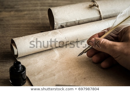 sheet of papyrus with ancient drawings stock photo © gbuglok