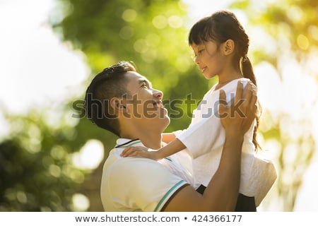 Father and daughter sitting on the beach together Stock photo © photography33