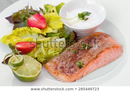 Stock photo: slices smoked fish and vegetables