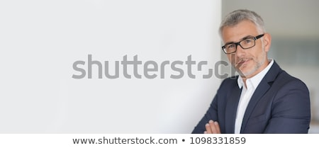 Mature businessman with banner. stock photo © Kurhan
