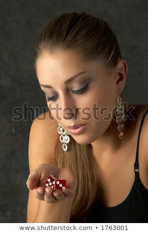 blowing on dice for good luck Stock photo © OleksandrO