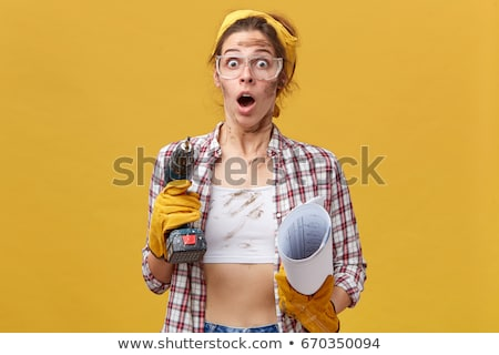 woman holding drill on white background stock photo © photography33
