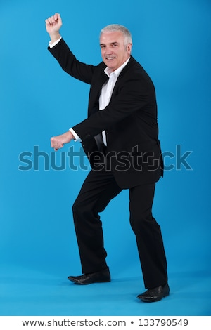 Senior businessman pretending to ride horse Stock photo © photography33