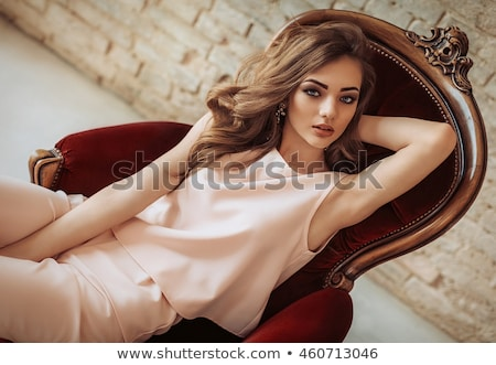 woman with beauty long brown hair posing in red dress posing at stock photo © victoria_andreas