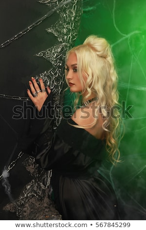 beautiful blonde vampire stock photo © marmeladka