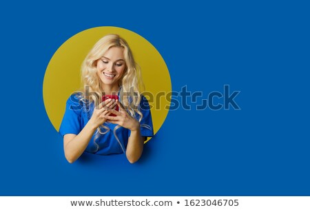 A woman making a hole in the wall. Stock photo © photography33