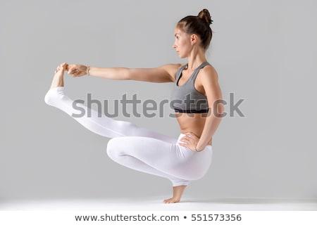 Belo flexível mulher jovem amarelo pano céu Foto stock © acidgrey