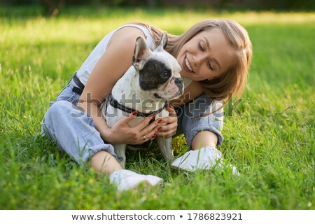 pretty young blonde posing with two dogs stock photo © acidgrey