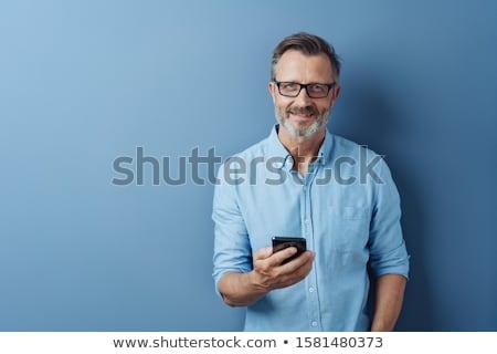 mosolyog · férfi · vonzó · szakállas · áll · karok - stock fotó © dash