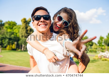 Cute guy in sunglasses Stock photo © curaphotography